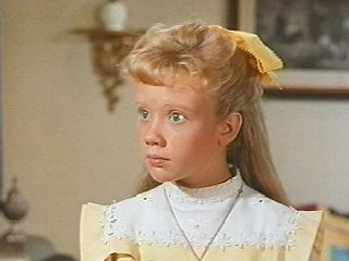 I was OBSESSED with Hayley Mills' costumes in Pollyanna. So gorgeous. The bows! (Image courtesy of Disney.com)